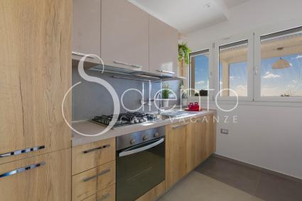 Open kitchen with electric oven and dishwasher