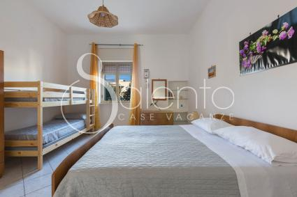 Four-bed room with double bed and bunk beds