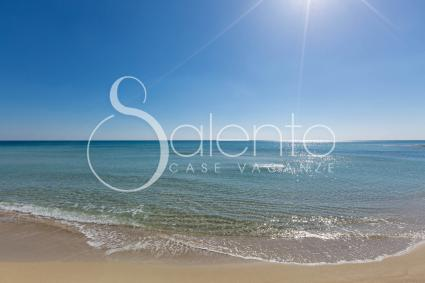 The sandy beach of Torre Lapillo with crystal clear water