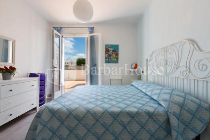 La camera da letto della casa vacanze nella zona di Porto Cesareo