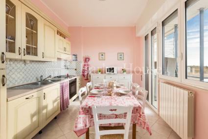The kitchen is equipped with electric oven, microwave oven and dishwasher