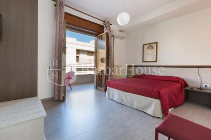 The bedroom of the two-room apartment for rent is a double room with access to the balcony