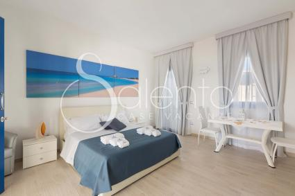 The room is furnished with modern furniture and equipped with air conditioning and internet