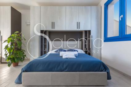 The room is modern and new, equipped with air conditioning
