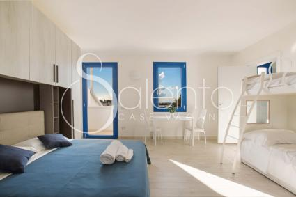 The room is furnished with a double bed, a bunk bed and a single pull out bed
