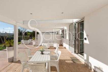 The outdoor veranda is furnished for relaxing outdoors