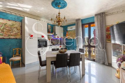 The apartment consists of a living room with a dining room, an open kitchen and a TV sofa