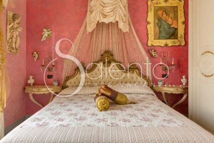 The pink bedroom has a four-poster bed